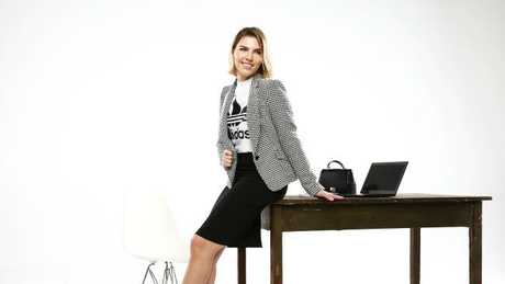 Model Lauren Day in active wear that you can wear to the office.