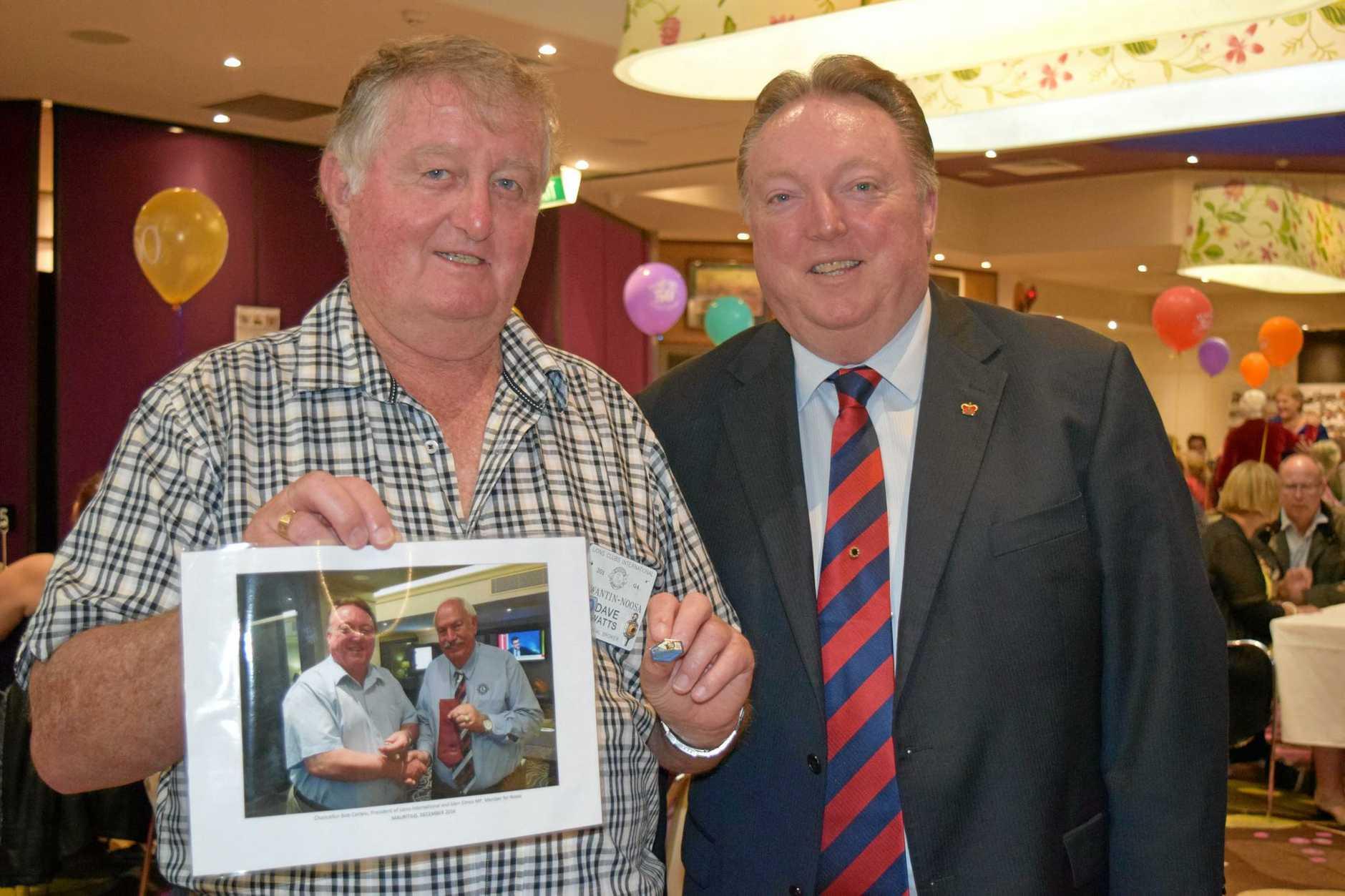 HONOUR: David Watts,  of Tewantin Noosa Lions Club, with MP Glen Elmes.