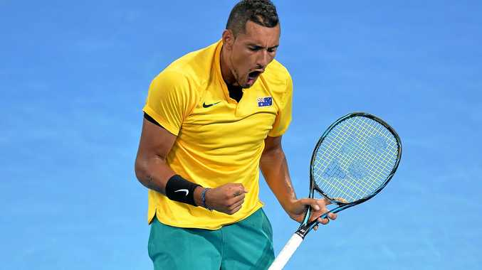 Nick Kyrgios celebrates winning a point in his match against John Isner of the USA