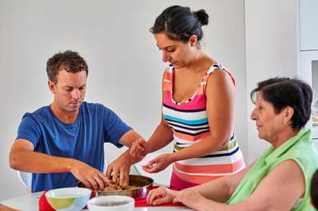 Ipswich man Simon McQuillan learns to cook Lebanese food with his bride Alene Khatcherian and her family during his Sydney homestay in a scene from Married At First Sight. Supplied by Channel 9.