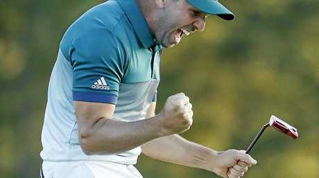 Sergio Garcia reacts after making his birdie putt on the 18th green to win the Masters