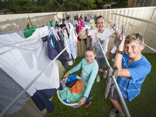 Jeremy Austin with his children Jake, 11 and Chelsea, 10, who help both their dad and mum with household chores.