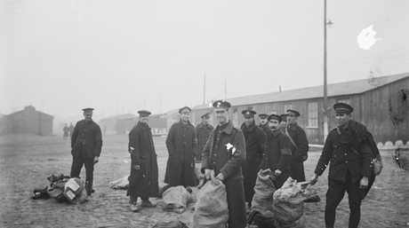 A group of repatriated British and Australian prisoners at a base depot in England after the Armistice. Most Australian prisoners captured on the Western Front survived captivity and the war. Picture: AUSTRALIAN WAR MEMORIAL (E04235)