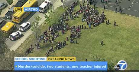 In this frame from video provided by KABC-TV, faculty and students evacuate North Park School Elementary School as emergency personnel respond to a shooting inside on Monday, April 10, 2017, in San Bernardino, Calif.