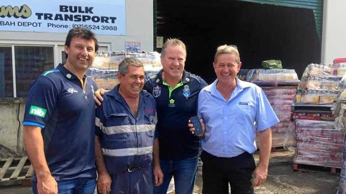 LEGENDS: Laurie Daley and Paul Langmack with Paul and Peter O'Connor assessing the damage to their business in South Murwillumbah.