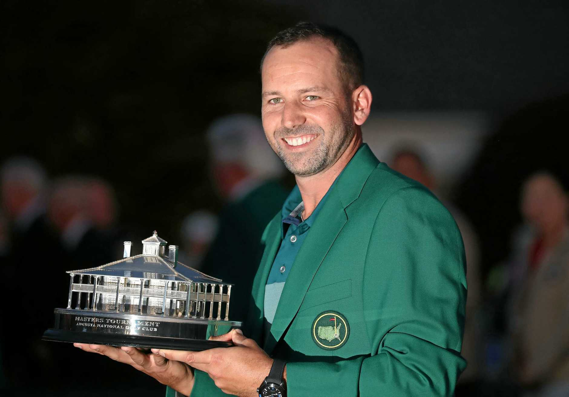 Sergio Garcia of Spain holds the Masters trophy after winning at Augusta.