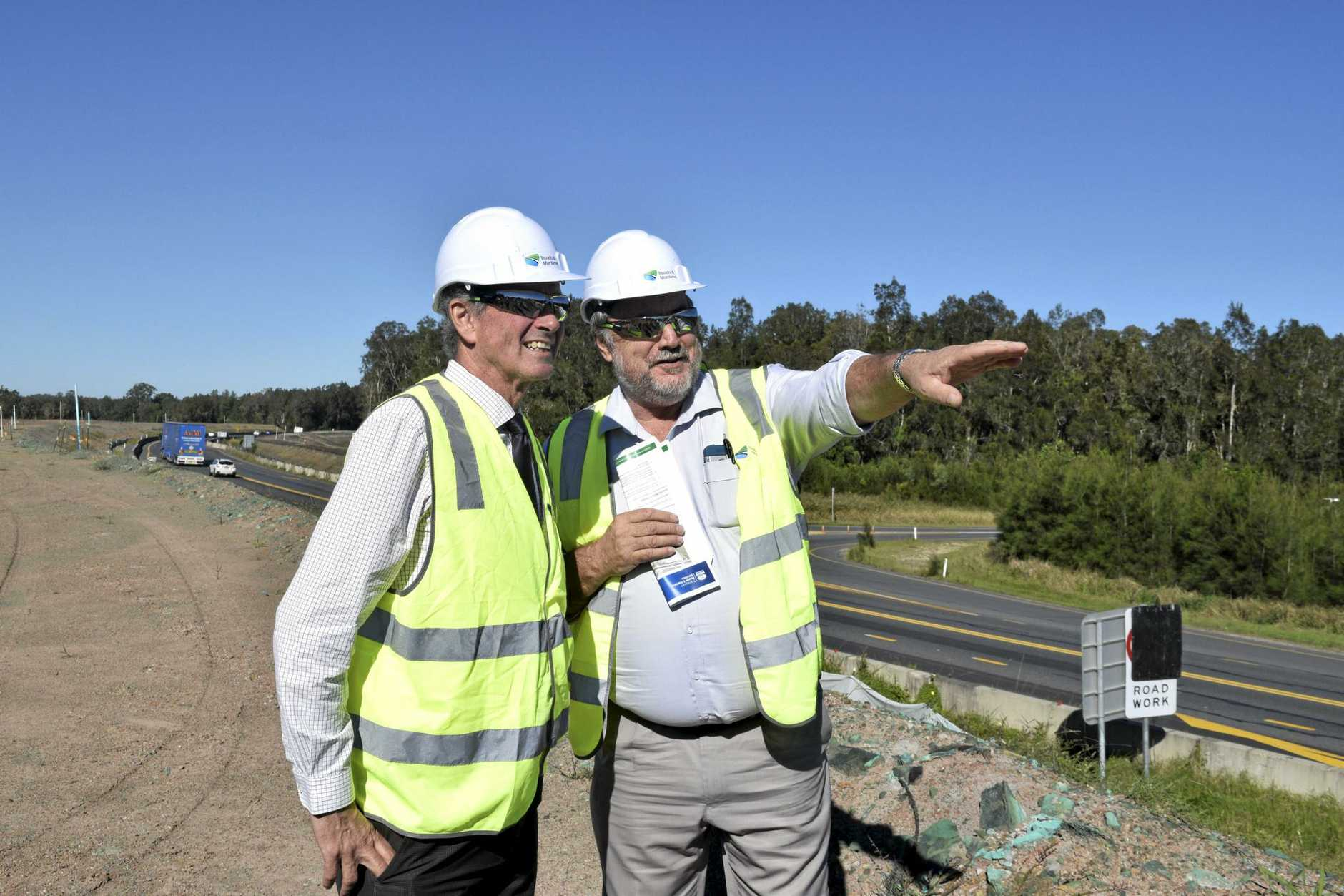 ALL YELLOW: Clarence MP Chris Gulaptis and RMS Pacific Hwy GM Bob Higgins take a look at the new yellow lines on the Pacific Hwy upgrade at Harwood.