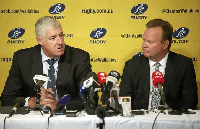 Australian Rugby Union Chairman Cameron Clyne, left, and CEO Bill Pulver discuss how the southern hemisphere Super Rugby tournament is reduced from 18 to 15 teams next season.