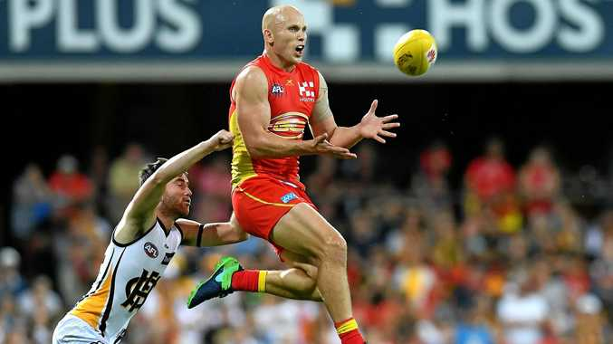 Gary Ablett of the Gold Coast Suns takes a mark.