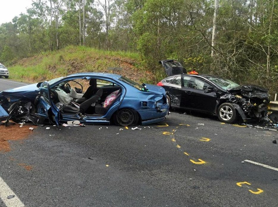 Two of the cars at the scene of a four-vehicle crash on the Bruce Hwy south of Tiaro.