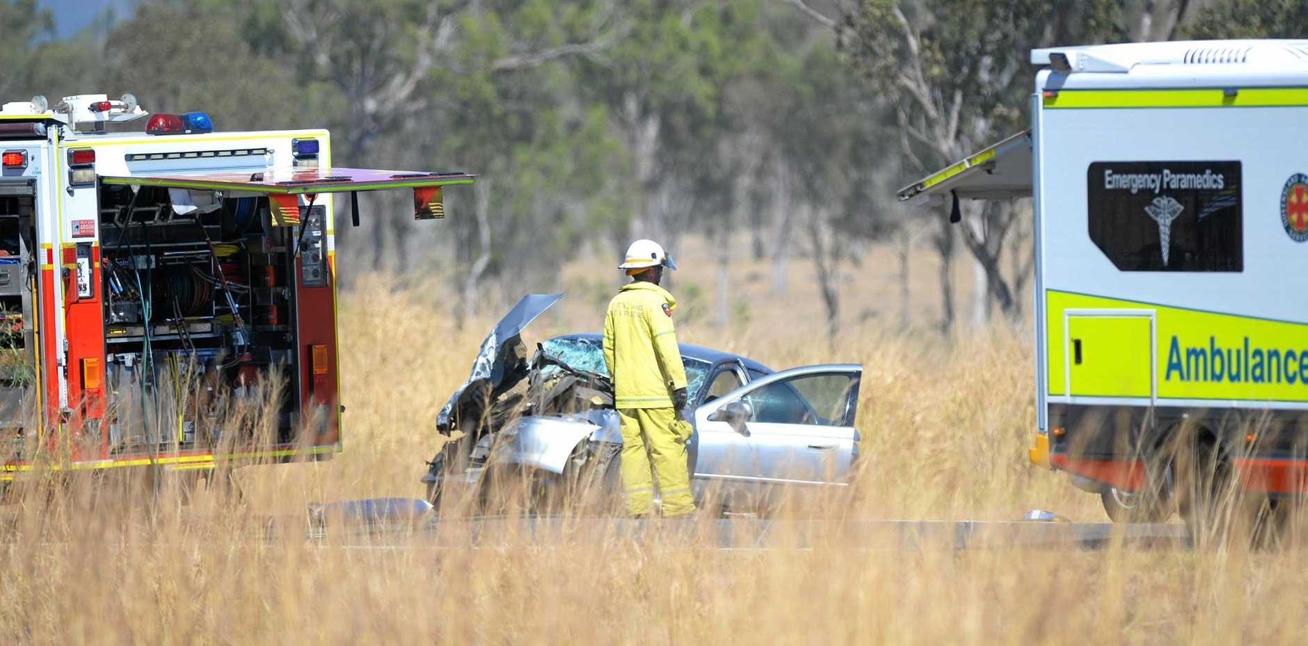 Emergency services at the scene of an accident south of Rockhampton on the Bruce Highway.