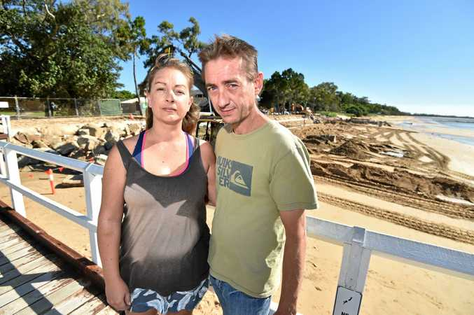 TERRIFYING EXPERIENCE: Sam and John Gould at Torquay Beach where they became trapped in sinking sand on Monday night.