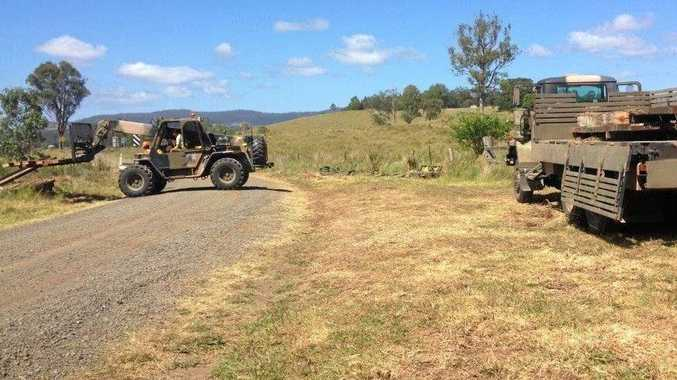 MILLION DOLLAR BOOST: Kyogle Council staff and soldiers working together on Kyogle bridges which are set to receive nearly $4M more if the council's draft budget is passed.