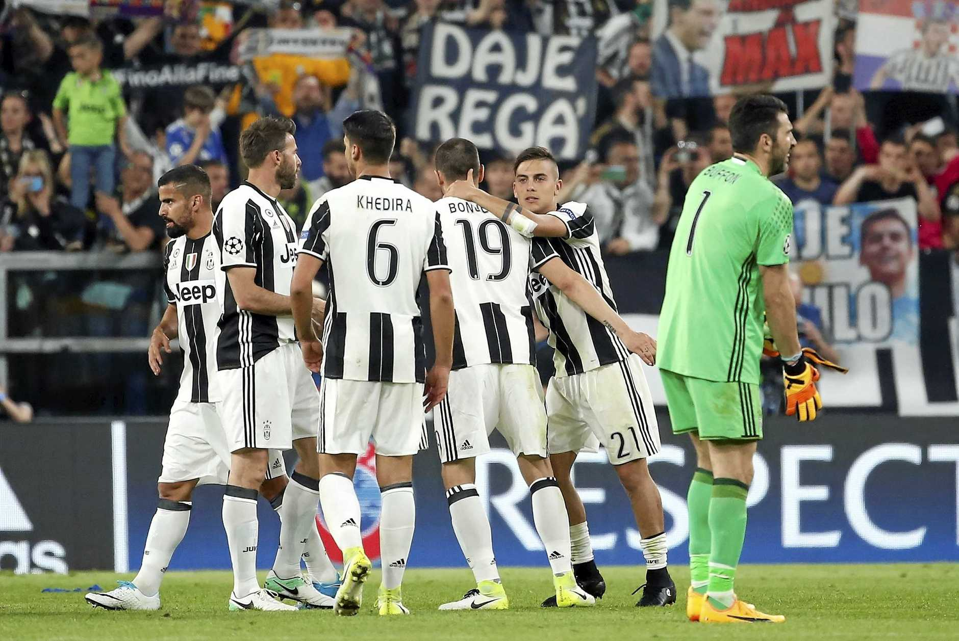 Juventus players celebrate their 3-0 win over Barcelona.