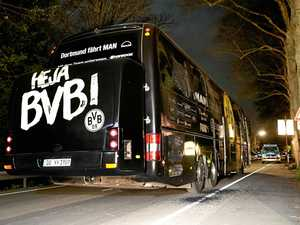 Player injured after three explosions near Dortmund bus