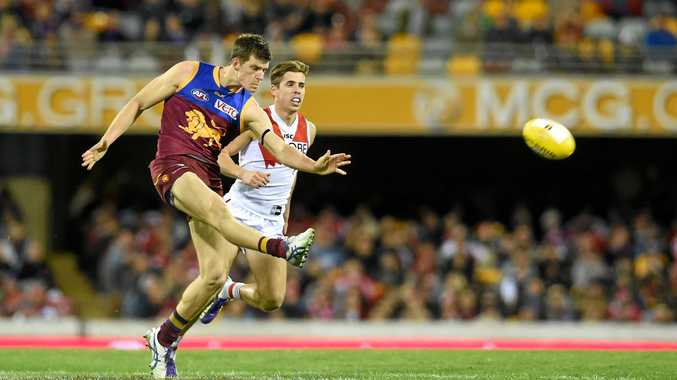 Justin Clarke of the Brisbane Lions kicks during their round 15 game against the Sydney Swans at the Gabba in Brisbane, Sunday, July 12, 2015. (AAP Image/Dan Peled) NO ARCHIVING, EDITORIAL USE ONLY