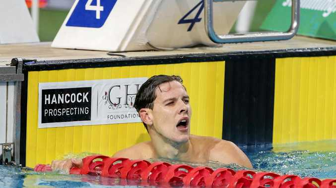 Mitch Larkin after winning the men's 100m backstroke title at the Australian Swimming Championships in Brisbane.