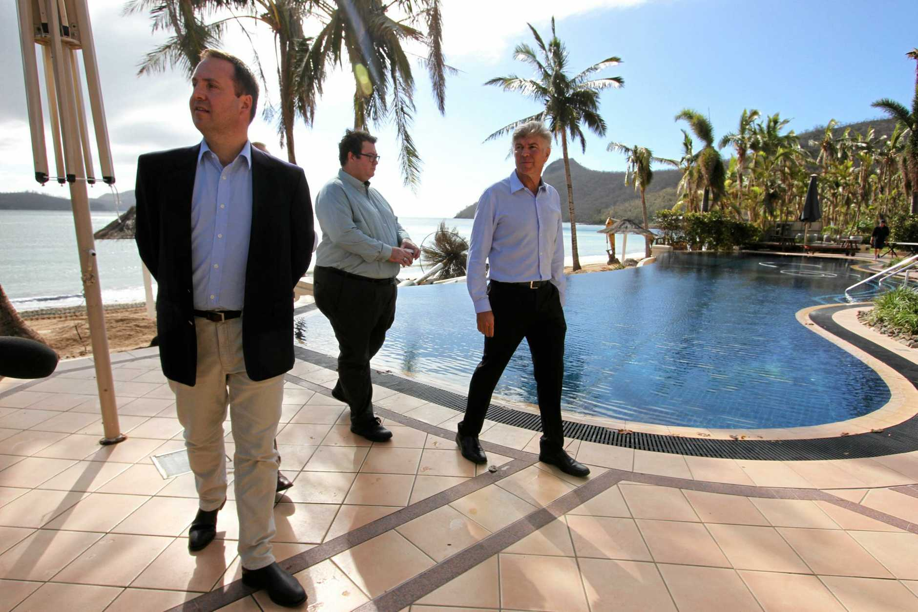 Hamilton Island CEO Glenn Bourke shows Federal Tourism Minister Steven Ciobo and Federal Member for Dawson George Christensen around the Beach Club.