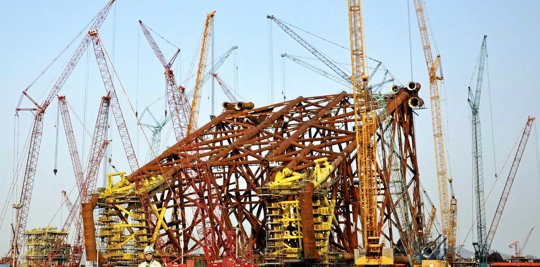 CHINA WATCH: Construction abounds at a subsidiary of China Offshore Oil Engineering Co Ltd in Qingdao, in eastern China's Shandong province.