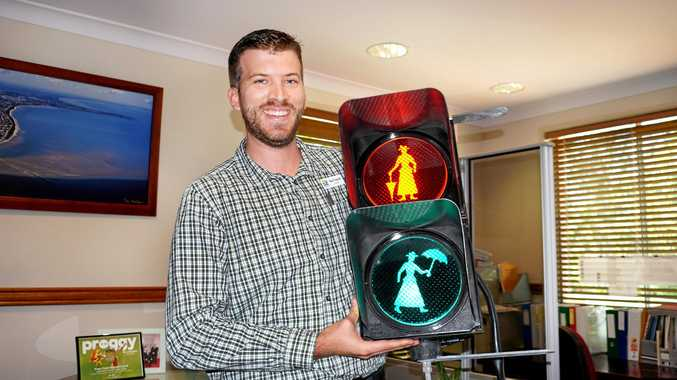 Councillor Paul Truscott with the Mary Poppins pedestrian lights, due to be installed in the CBD after a successful council motion.