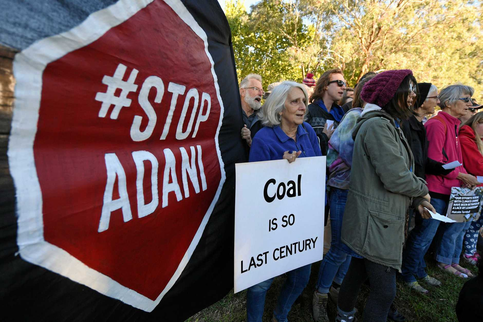 NOT DIGGING IT: Opponents of the proposed Adani coal mine in Queensland protest yesterday outside the Indian High Commission in Canberra.