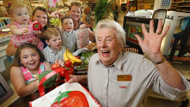 Coles' longest-serving checkout chick, 85-year-old Brenda Palmer, pictured with her grandchildren and great grandchildren, this year celebrates her 50th year working at the Coles Malvern store. Picture: Alex Coppel