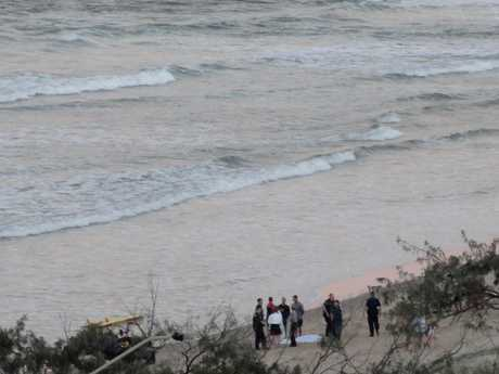 A grandmother has died in a drowning at Alexandra Headland.