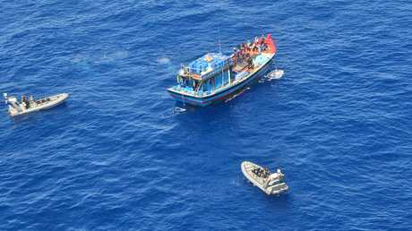 NABBED: The moment a Vietnamese fishing vessel and its crew of 15 men suspected of illegally fishing near Saumarez reef in the Coral Sea Commonwealth Marine Reserve were apprehended.