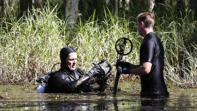 Water Police and Army dive squad conduct a search around wetlands at Sandgate , Brisbane, April, 11, 2017 in relation to disappearance of 29-year-old Wayne Youngkin in 1986. His skeletal remains were found in a disused septic tank at Brighton, north of Brisbane in 2016.