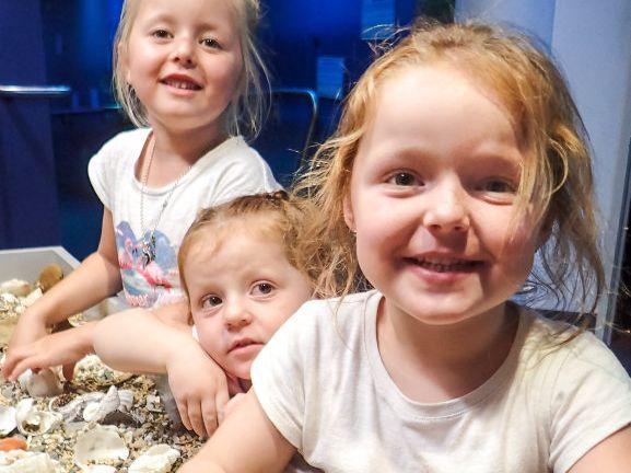 Lanie, Isla and Eden Hazeltine enjoy school holidays at the Solitary Islands Aquarium.