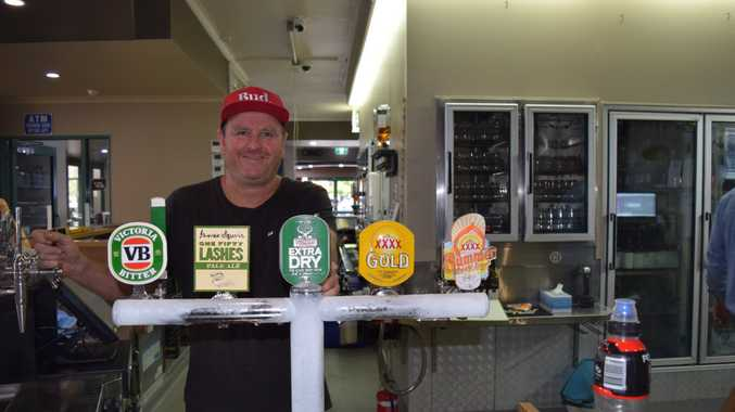 OPEN FOR BUSINESS: Torquay Hotel manager Darren Carter behind the bar at the refurbished pub after storm damaged the inside.
