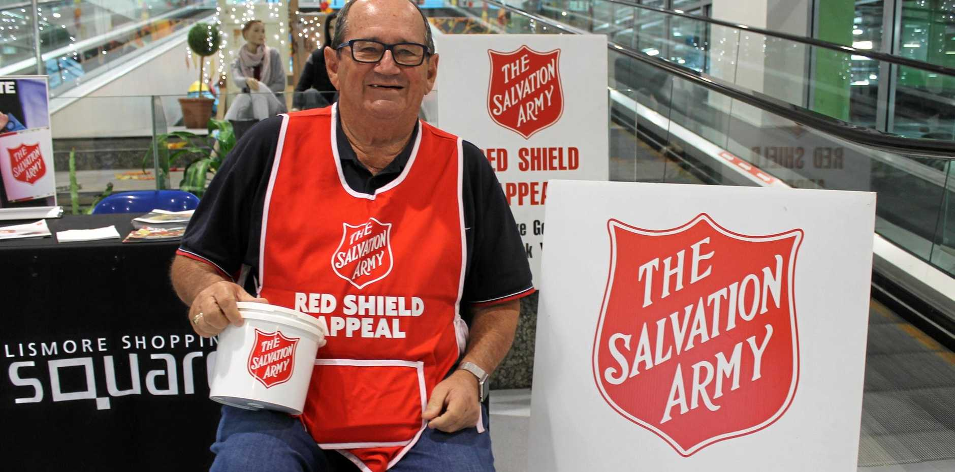 FUNDS FOR FLOOD VICTIMS: Former Lismore branch manager of the St George Building Society, David Harris, enjoyed helping the Salvation Army during the Red Shield Appeal last year.