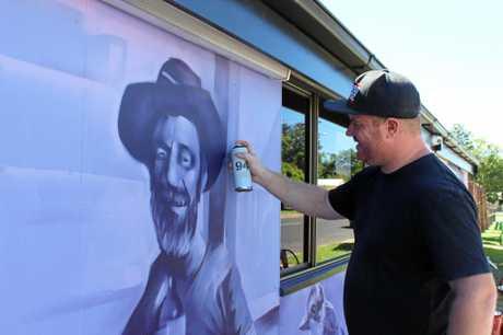 Illustrator, designer and artist James Alley working on Anakie Gemfields Hotel Motel.
