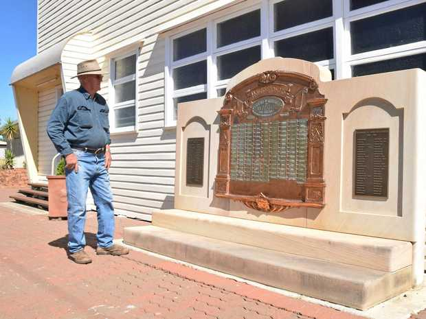 PRIDE AND HONOUR: Warra Memorial Hall president Jeff Taylor looks over the town's 100-year-old war honour board.