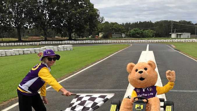 READY TO RELAY: Sarah Whitaker from Cancer Council NSW and Dougal Bear get ready for Relay for Life 2017 at the Coffs Go Kart Track.