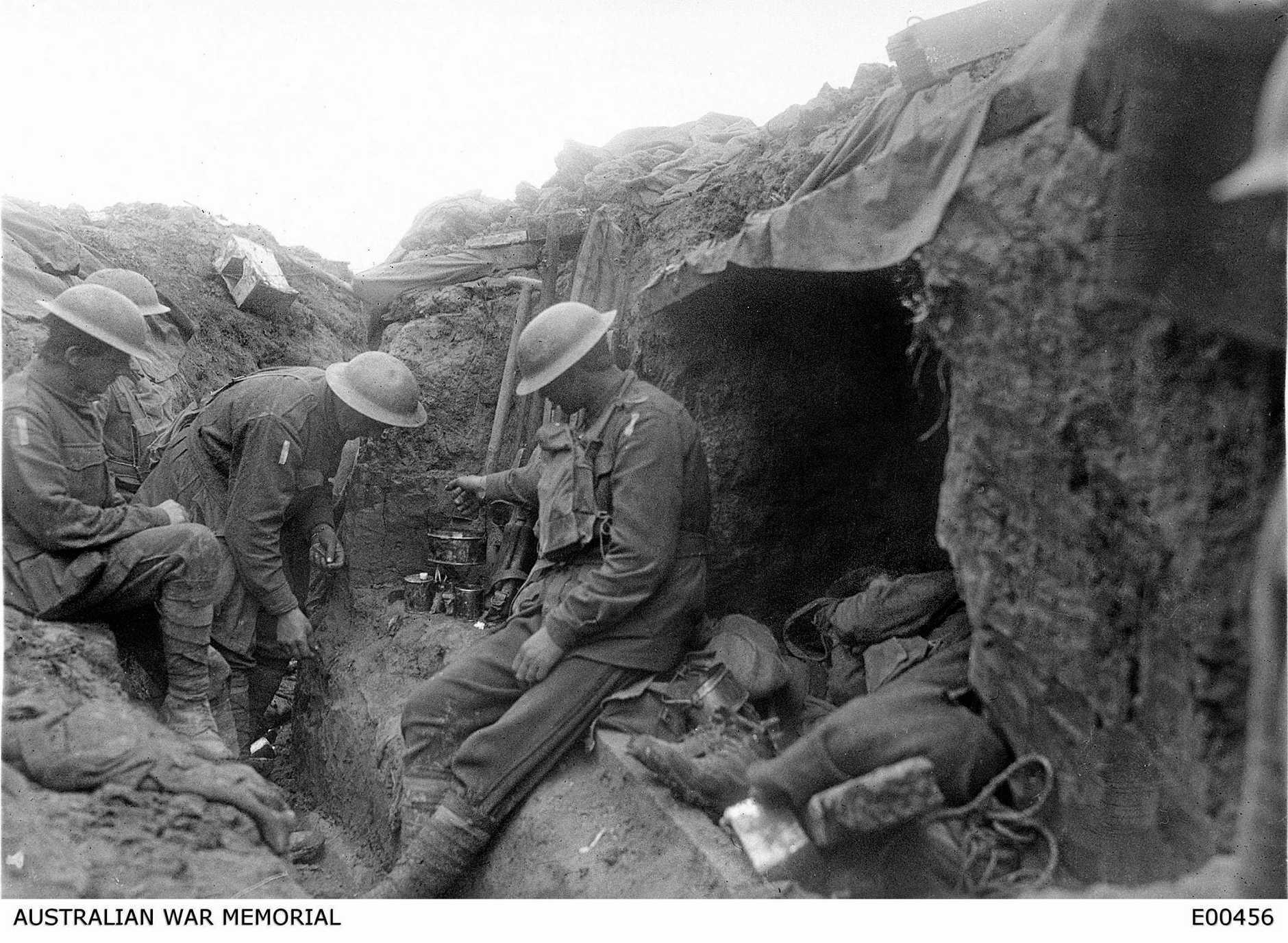 TOUGH CONDITIONS: Three soldiers warm a mess tin of tea over a candle in the reserve line during the fighting near Bullecourt.