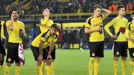 Dortmund's Nuri Sahin, Sokratis Papastathopoulos, Lukasz Piszczek, Matthias Ginter and Julian Weigl, from left, react after losing 2-3 during the Champions League quarter-final