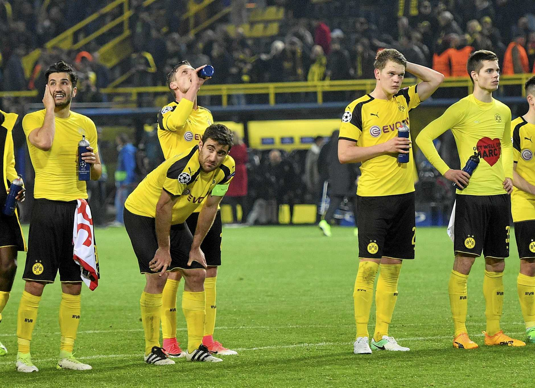 Dortmund's Nuri Sahin, Sokratis Papastathopoulos, Lukasz Piszczek, Matthias Ginter and Julian Weigl, from left, react after losing 2-3 during the Champions League quarter-final
