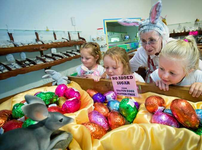 EGG-CELLENT CHOICE: Eden, Isla and Lanie Hazeltine with Jean Hamey marvel at the carob bilby and Easter eggs available from the Carobana Factory at Korora.