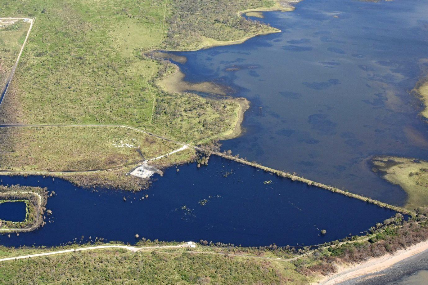 Adani says dams prevented coal from the Abbot Point coal terminal washing into the the Caley Valley wetlands after Cyclone Debbie.