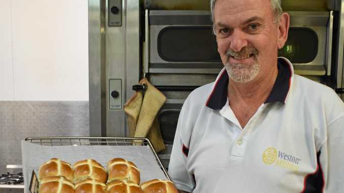 OVEN FRESH: Brad Steele is all ready for Easter with his fabulous, freshly made hot cross buns.