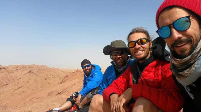 SILK ROAD PIRATES: Kristan Fischer, Avirup Bagchi, Lawrence Alexander and Juan Guerrero in the Taklamakan Desert.