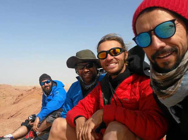 SILK ROAD PIRATES: Kristan Fischer, Avirup Bagchi, Lawrence Alexander and Juan Guerrero in the Taklamakan Desert.