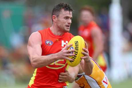 Pearce Hanley gets the ball away against the Lions.  (Photo by Chris Hyde/Getty Images)