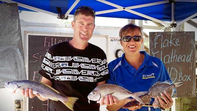 Ballina fishers John and Julie Joblin in their stall at the Mullumbimby Farmers' Market. PHOTO: KATE O'NEILL