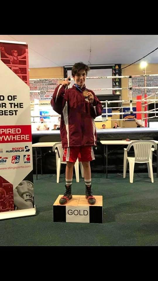 GOING THE DISTANCE: Local boy Austin Savage brings home gold at the Australian Boxing Championships.