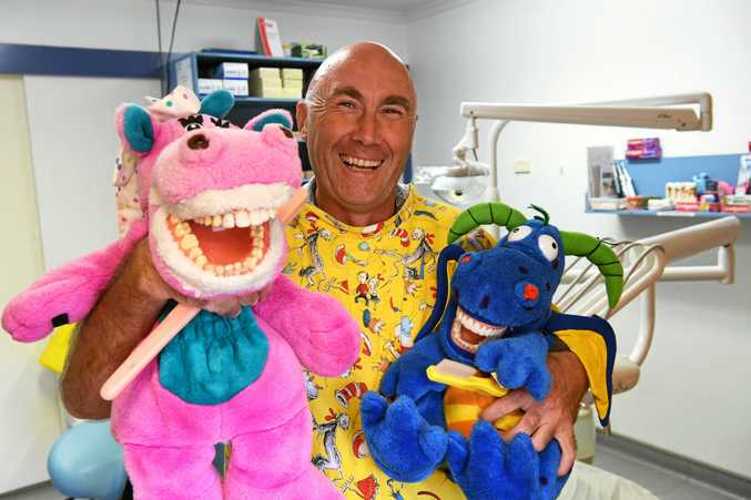 BRUSH REGULARLY: Dental therapist Mal Cottle with Flossy and Squirt.