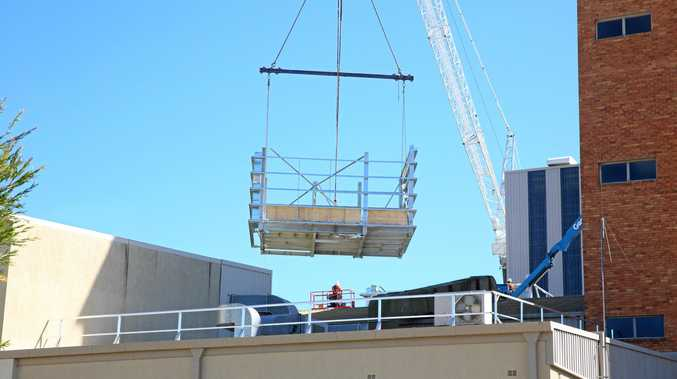THE BIG LIFT: Structures being added to the Nestle factory in Gympie.