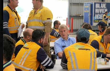 Energex workers chat with Mirani MP Jim Pearce.