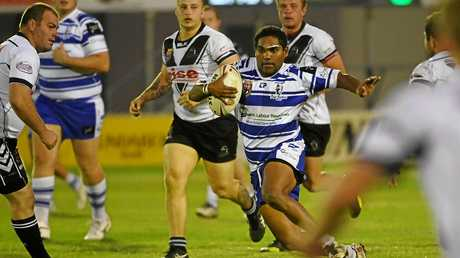 WEAVING THROUGH: William Nagas finds a gap for Past Brothers in the BRL game at Salter Oval in Bundaberg.